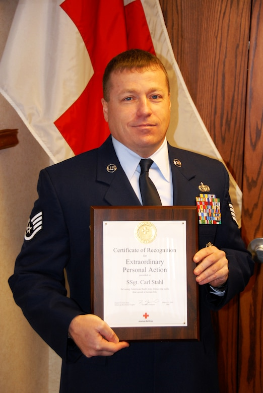 Staff Sgt. Carl Stahl, 180th Fighter Wing Security Forces, Ohio Air National Guard, was honored by the Greater Toledo Area American Red Cross Chapter March 11. Staff Sgt Stahl was presented with a Certificate of Recognition for Extraordinary Personal Action after he aided in stabilizing a seriously injured driver at the scene of a car accident until rescue crews arrived. USAF Photo by Master Sgt. Ed Wagner (Released).