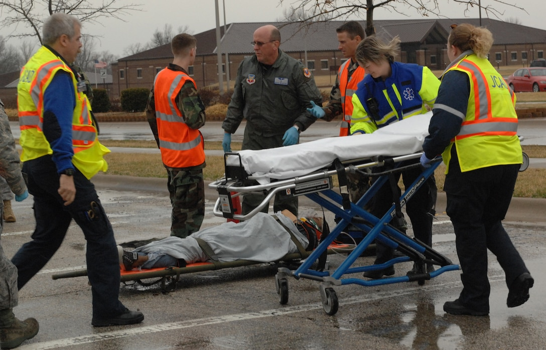 WHITEMAN AIR FORCE BASE, Mo. - Members of the 509th Medical group work with Members of the Johnson County Emergency services, perform medical treatments to victims during a Major Accident Response Exercise March 10. The MARE was conducted base-wide excluding Whiteman Elementary School and any personnel directly involved with flying operations.(U.S. Air Force photo/Senior Airman Cory Todd)