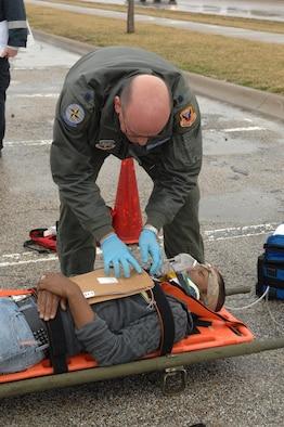 WHITEMAN AIR FORCE BASE, Mo. - Lt. Col. Bruce Woodford, 509th Medical Operations Squadron, provides medical care to a victim during a Major Accident Response Exercise March 10. The MARE was conducted base-wide excluding Whiteman Elementary School and any personnel directly involved with flying operations. (U.S. Air Force photo/Senior Airman Cory Todd)