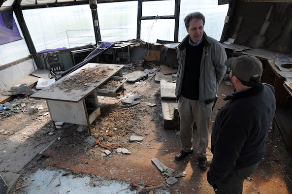 Bill Harris (wearing hat), 48th Fighter Wing Historian discusses some of the intricate details of the old air traffic control tower here with Joe Koziar, a fourth-grade school teacher at Feltwell Elementary School. They were taking a final look Feb. 27, 2009 to document the building before it's demolished. The tower has fell into disarray since being abandoned in 1992. (U.S. Air Force photo by Staff Sgt. Nathan Gallahan)