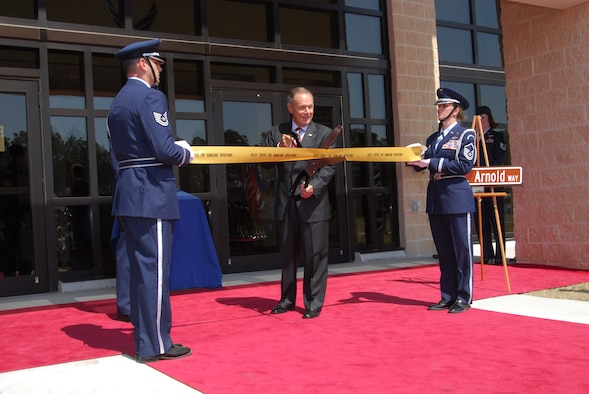 Maj. Gen. Philip Killey, former 1st Air Force commander, cuts the ribbon,