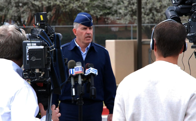 Col. Steven H. Slick, 94th Mission Support Group commander, speaks to Atlanta media about the joint response by the City of Marietta and Dobbins Air Reserve Base, Ga., to a bomb threat near the base's main gate March 11, 2009.  (U.S. Air Force photo/Tech. Sgt. James Branch)