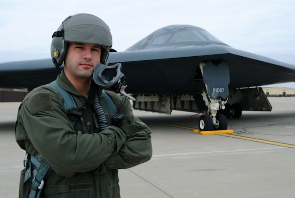 WHITEMAN AIR FORCE BASE, Mo. - Staff Sgt. Zachery Teague, 509th Aircraft Maintenance Squadron, stands in front of a B-2 Stealth Bomber March 13 after he has received the first enlisted incentive flight in a B-2. Sergeant Teague received this flight for being named the 2008 509th Maintenance Group Crew Chief of the Year. (U.S. Air Force Photo / Airman 1st Class Carlin Leslie)