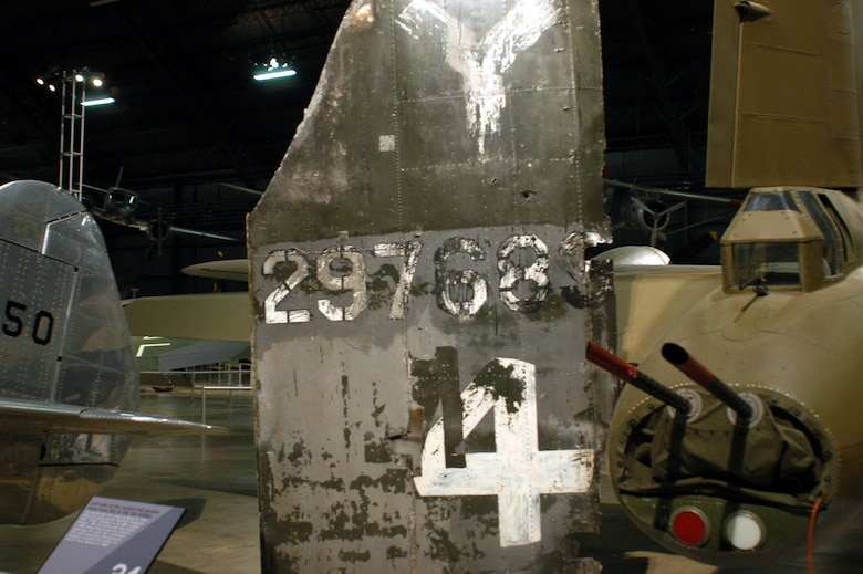 """DAYTON, Ohio -- In 1993, the tail section of the aircraft that Tech. Sgt. Sator """"Sandy"""" Sanchez was shot down in March 15, 1945, was discovered being used as part of a farmer's shed near the crash site.  Nine members of the 52nd Equipment Maintenance Squadron with four surviving crewmembers, recovered the tail section of B-17 42-97683 for the National Museum of the United States Air Force March 15, 1996, where it remains on display. (Courtesy photo)"""