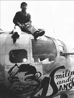 """SUFFOLK, England – Tech. Sgt. Sator """"Sandy"""" Sanchez, 95th Bomb Group, sits atop a B-17. The new plane was emblazoned with a caricature of him, the name Smilin' Sandy Sanchez and the number 44. This was the first, and only, such tribute to a crewmember in the entire 8th Air Force. It was also the only B-17 known to have been named for an enlisted Airman. (Courtesy photo)"""