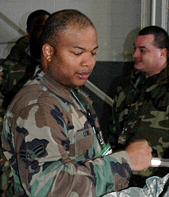 Airman 1st Class Eukenya Lewis, a reservist with the 38th Aerial Port Squadron, stood as an alternate for his team at the first 22nd Air Force Aerial Port ROUNDUP March 13-15 at Dobbins Air Reserve Base, Ga. Airman Lewis is also a squad corporal at The Citadel in South Carolina. (U.S. Air Force photo/Capt. Bryan Lewis)