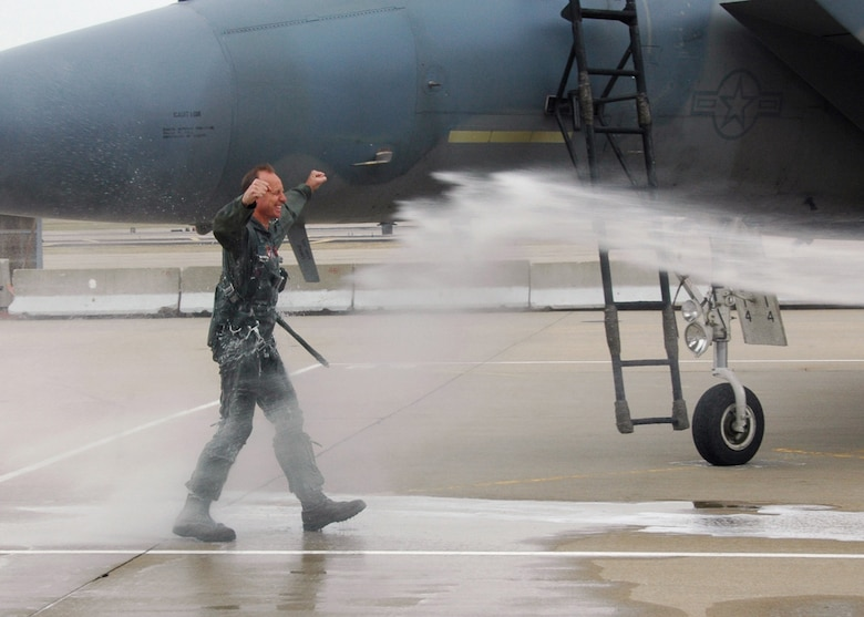 "Doused!  Col Jon ""JB"" Kelk is doused with a firehose in honor of his final F-15 flight at the 131st Fighter Wing, Missouri Air National Guard, at Lambert-Saint Louis Airport on March 12.  Col Kelk was the first ever pilot to log over 4000 hours in F-15 model aircraft and still holds the record with over 4160 flying hours.  (U.S. Air Force Photo by Master Sergeant Mary-Dale Amison)"