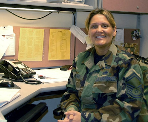 Senior Master Sgt. Jo-Ann Decker, the superintendent for the 128 Air Refueling Wing's Judge Advocate General's office, prepares for her January drill at the General Mitchell Air National Guard Base in Milwaukee, WI.  Decker recently accepted the positions of senior paralegal for JAG's Legal Information Systems and the ANG's officer liaison to JAG's Legal Information Systems.