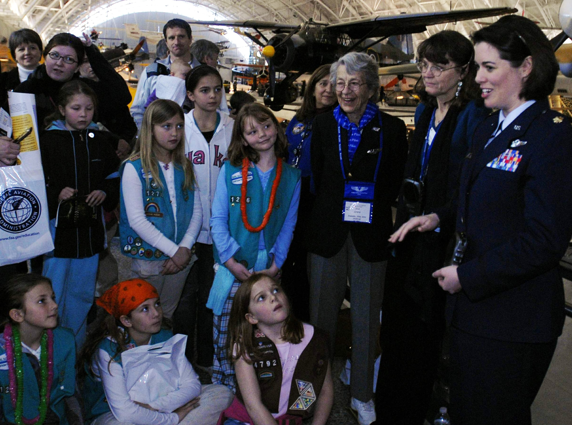 Maj. Nicole Malachowski answers questions at the Women in Aviation and Space Family Day March 14 at the National Air and Space Museum's Hazy Center in Chantilly, Va. The event featured female air and space pioneers, including astronauts, a World War II Women Airforce Service Pilot and several aerospace experts at exhibit booths where visitors could learn hands-on about science and flying. Major Malachowski was the first female Thunderbirds pilot. (U.S. Air Force photo/Staff Sgt. J.G. Buzanowski)