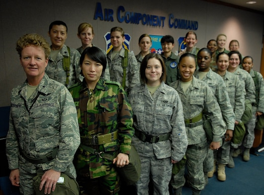 OSAN AIR BASE, Republic of Korea --  Female Airmen representing the United States and Republic of Korea Air Forces gather together to show their unity for Women's History Month during the Key Resolve/Foal Eagle 09 exercise here. The women represent a variety of ranks and job specialties within the Air Component Command. The annual air and space portion of Key Resolve demonstrates U.S. resolve to support the Republic of Korea against external aggression while improving ROK-U.S. combat readiness and joint/combined interoperability. (U.S. Air Force photo/Staff Sgt. Benjamin Rojek)