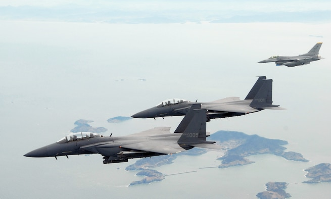 Training together: Republic of Korea Air Force F-15 fighters on a joint training mission with a USAF F-16 Fighting Falcon over South Korea. (U.S. Air Force photo/Staff Sgt. Jason Colbert)
