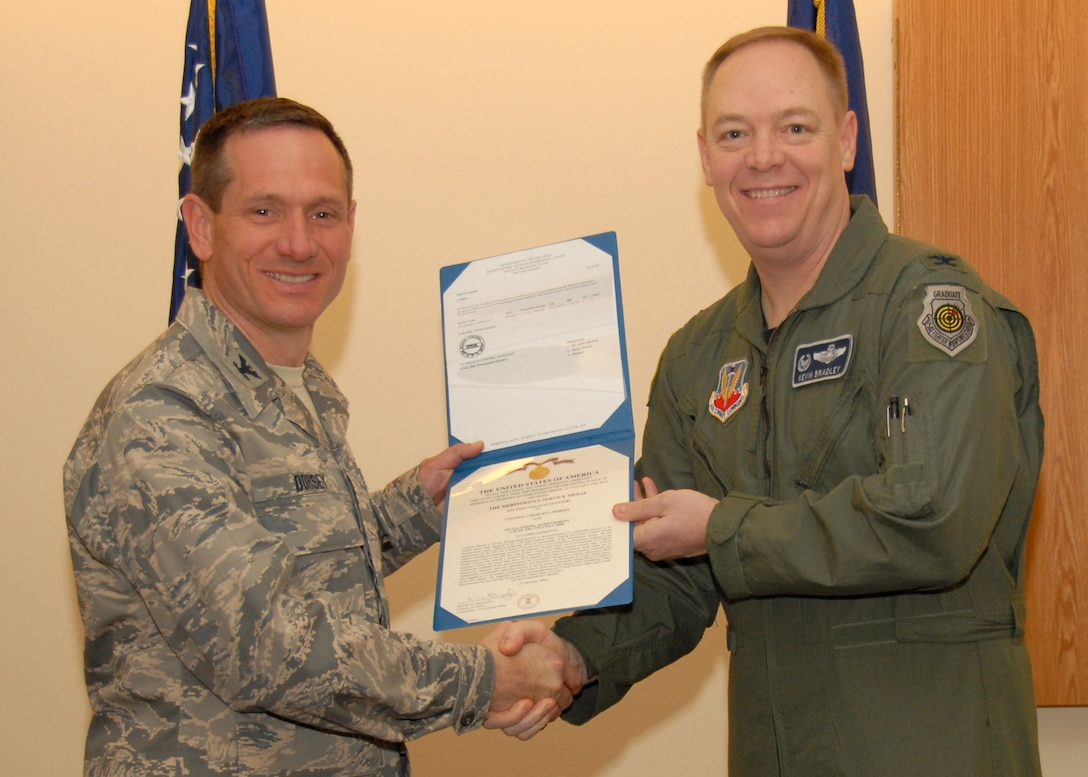New York Air National Guard 174th Fighter Wing Vice Commander Col. Charles S. Dorsey receives the Meritorious Service Medal from New York Air National Guard 174th Fighter Wing Commander Col. Kevin W. Bradley at Hancock Field in Syracuse, NY., on March 7, 2009.(U.S. Air Force photo by Tech. Sgt. Jeremy M. Call/Not Released)