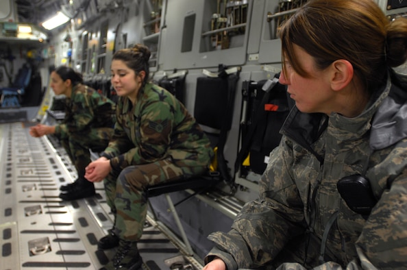 U.S. Air Force Master Sgt. Hollie Heath (right), 721st Aircraft Maintenance Squadron production superintendent, discuses Women's History Month with her troops, Senior Airman Lissa Nelson and Senior Airman Charlene Harding, at the end of a night mission aboard a U.S. Air Force C-17 Globemaster III, March 5, 2009, Ramstein Air Base, Germany. Sergeant Heath explained how she's experienced changes in the military world for women as time progressed. Women's History Month was made official in 2000 when President Bill Clinton signed a proclamation designating the month of March for reflection upon the great strides women have made over time. (U.S. Air Force photo by Airman 1st Class Kenny Holston)