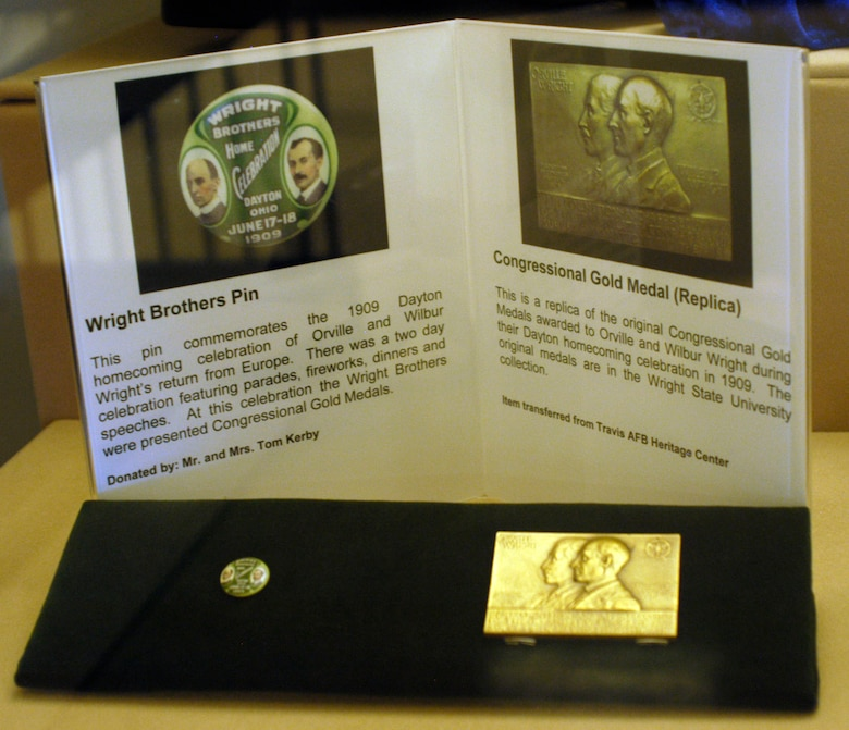 The Wright Brothers Pin and replica Congressional Gold Medal honored Orville and Wilbur Wright during their 1909 Dayton homecoming celebration. (U.S. Air Force photo)