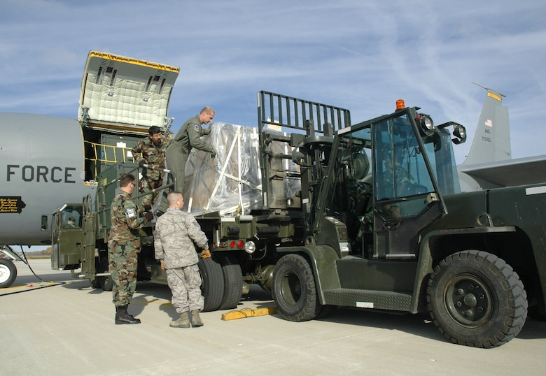 Members of the 34th Aerial Port Squadron unload a KC-135R Stratotanker at General Mitchell Air National Guard Base, Milwaukee, WI.  The 34th APS, formerly attached to the 440th Air Reserve Base, works alongside the 128th Air Refueling Wing to meet the mission requirements for the state of Wisconsin and in the Global War on Terror.  (Air Force photo by Master Sgt. Kenneth Pagel)