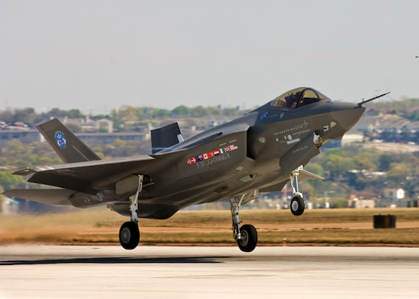 Maj. Joseph Bachmann, a developmental test pilot for the F-35 Lightning II, takes off in an F-35 AA-1 March 19 from the runway at the Lockheed Martin Aeronautics plant here. Bachmann was the first Marine to fly the aircraft and has been training to fly the multirole, stealth-capable, supersonic joint strike fighter aircraft for more than two years. The Marine Corps will field the F-35B variant of the aircraft, which is short take-off and vertical landing capable.