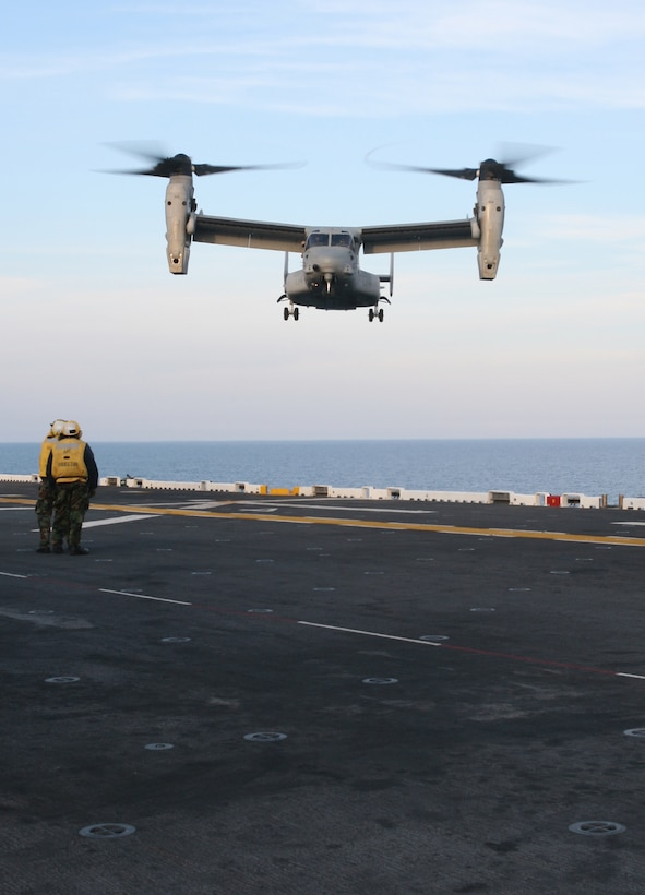 An MV-22B Osprey lands on the flight deck of USS Bataan during flight operations, Mar. 19, 2009, as part of the 22nd Marine Expeditionary Unit's Certification Exercise. CERTEX is the last training hurdle before the MEU's upcoming deployment this spring. (Official Marine Corps photo by Cpl. Justin M. Martinez)