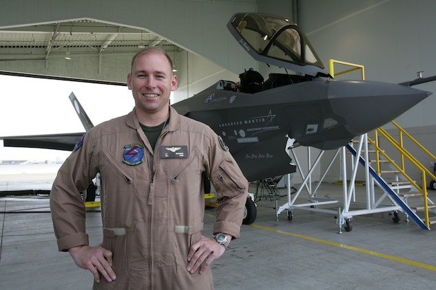 "Maj. Joseph ""O. D."" Bachmann, a developmental test pilot for the F-35 Lightning II, stands in front of the F-35 AA-1, moments after successfully flying it from the Lockheed Martin Aeronautics plant here March 19. Bachmann, a native of Topeka, Kan., was the first Marine pilot to fly the multirole, stealth-capable, supersonic joint strike fighter aircraft that will be replacing three of the Navy and Marine Corps' aircraft."