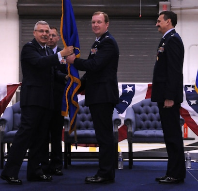 NIAGARA FALLS AIR RESERVE STATION, N.Y. - Col. Allan Swartzmiller (center) accepts the 914th Airlift Wing unit flag from Maj. Gen. Martin Mazick (left), 22nd Air Force commander.  Col Swartzmiller takes over as commander of the 914th Airlift Wing from Col. Reinhard Schmidt (right).  (U.S. Air Force photo by Senior Airman Stephanie Clark)