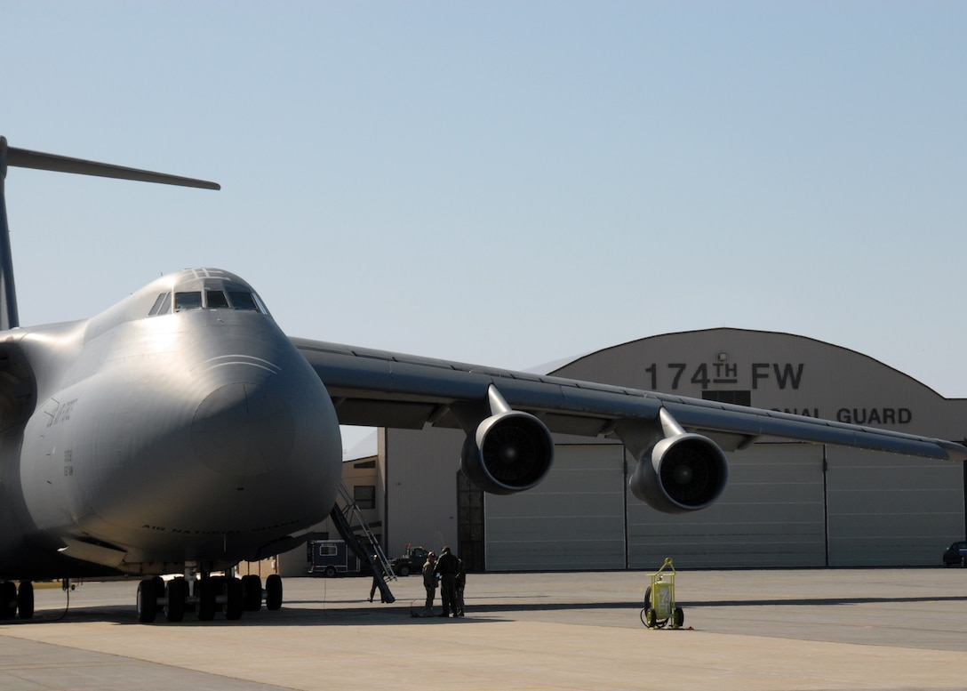 New York Air National Guard C-5A Galaxy from the 105th AW Newburgh, NY is parked on the flight line at the 174th FW in Syracuse, NY.  The Galaxy is going to be taking 174th FW members to Nellis Air Force Base in support of the Weapons Instructor Course. 174FW photo by SSgt Ricky Best.