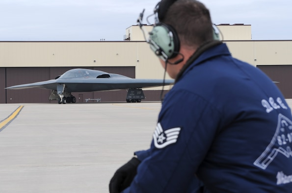 "WHITEMAN AIR FORCE BASE, Mo. – Staff Sgt. Tyler Brantley, 509th Aircraft Maintenance Squadron dedicated crew chief, takes a knee in front of the ""Spirit of Arizona"" B-2 Stealth Bomber as it taxis in March 13. Sergeant Brantley is the dedicated crew chief assigned to the Spirit of Arizona and friend of Staff Sergeant Zachery Teague, 509th Aircraft Maintenance Squadron.  Sergeant Teague received the first enlisted flight in the B-2 for being named the 509th Maintenance Group Crew Chief of the Year for 2008. (U.S. Air Force photo/ Airman 1st Class Carlin Leslie)"