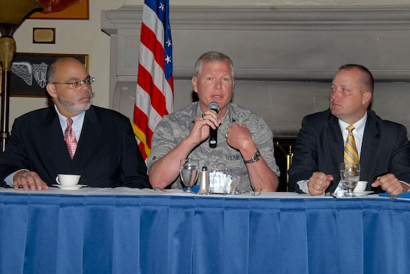 Col. Joseph Dent, Staff Judge Advocate General, addresses the audience during this year's Judicial Breakfast at the Maxwell Officers' Club, March 9. Also shown are Judge Wallace Capel (left), U.S. Magistrate Judge for the Middle District of Alabama in Montgomery and Capt. Keith Barnett, Montgomery Police Department. The breakfast is an annual event hosted by the International Officer School, for the purpose of acquanting international students with the American judicial system. (U.S. Air Force photo by Jamie Pitcher)