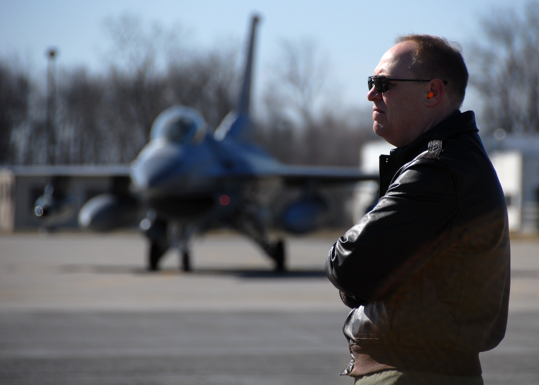 New York Air National Guard 174th Fighter Wing Commander Col. Kevin W. Bradley awaits the takeoff of the six F-16c Fighting Falcons on Hancock Field, Syracuse NY., on March 21, 2009. The F-16's were leaving for their final scheduled deployment. (U.S. Air Force photo by Tech. Sgt. Jeremy M. Call/Released)