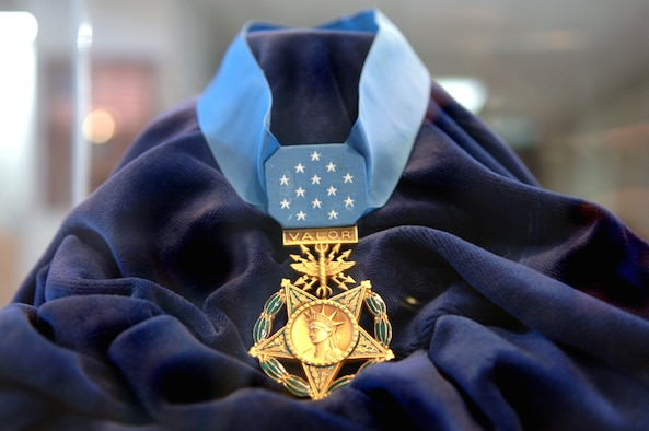 "The Medal of Honor is the highest military decoration awarded by the United States government. It is bestowed on a member of the United States armed forces who distinguishes himself ""conspicuously by gallantry and intrepidity at the risk of his life above and beyond the call of duty while engaged in an action against an enemy of the United States."" Because of the nature of its criteria, the medal is often awarded posthumously. (U.S. Air Force photo/Airman 1st Class Veronica Salgado)"