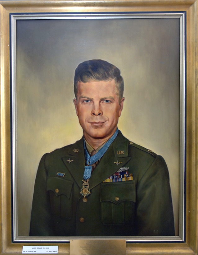 """Richard Ira """"Dick"""" Bong (Sept. 24, 1920 - Aug. 6, 1945) is the United States' highest-scoring ace, having shot down 40 Japanese aircraft during World War II, and is a Medal of Honor recipient. He was a fighter pilot in the U.S. Army Air Forces assigned to the 49th Pursuit Group (now the 49th Fighter Wing at Holloman Air Force Base, N.M.). His portrait hangs in the wing headquarters building along with photos from his days as a """"Fightin' Forty-Niner."""" (U.S. Air Force photo/Airman 1st Class Veronica Salgado)"""