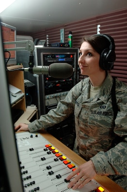 Senior Airman Holly Roberts, a broadcaster with the 732nd Expeditionary Support Squadron's American Forces Network-Iraq, runs the switchboard during her radio broadcast March 4 in Baghdad. Airman Roberts is deployed from Spangdahlem Air Base, Germany.  (U.S. Air Force photo/Tech. Sgt. Craig Lifton)