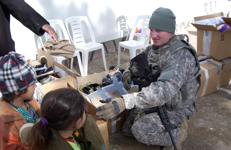 Nearly 200 children waited anxiously as Staff Sgt. Josh Paden and the members of the Zabul Provincial Reconstruction Team distributed the boxes filled with donations. Sergeant Paden, with the help of his mother, Diane Paden and the Pendleton County community in West Virginia, were able to give shoes, clothes and toys to the children of Qalat City, Afghanistan. (U.S. Air Force photo by 1st Lt. Amber Balken)