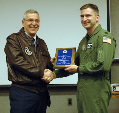 NIAGARA FALLS AIR RESERVE STATION, N.Y. - Maj. Gen. Martin Mazick, commander of 22nd Air Force (left), presents Capt. Anthony Wilmot of the 914th Airlift Wing with the 22 AF Outstanding Aircrew Flight Equipment Officer award for 2008.  (U.S. Air Force photo by Tech. Sgt. Kevin Nichols)