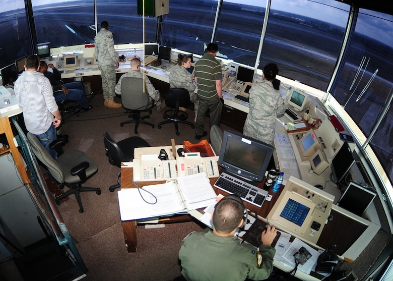 Airmen with the 4th Operations Support Squadron's Airfield Operations Flight manage the air space from the air traffic control tower on Seymour Johnson Air Force Base, N.C., March 20, 2009. The role of the Airmen in the tower is to help the airfield run smoothly. Ground control, supervisor of flying, and watch supervisor are just a few of the jobs that Airmen accomplish while working in the tower. (U.S. Air Force Photo by Airman 1st Class Rae Perry)