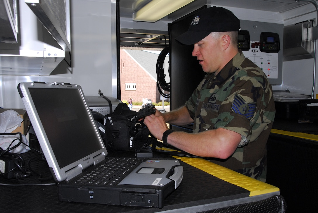 U.S. Air Force Technical Sgt. Tod Swenson, 148th Fighter Wing Communications Squadron, operates a communication network in the Joint Communications Platform (JCP) Aug 23, 2008 in Duluth, Minn. The JCP is one of two mobile communications platforms in Minnesota.  It provides satellite uplink and downlink, telephone, radio, data, and wireless capabilities to provide command and control functions.