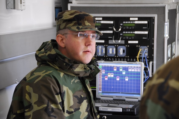 U.S. Air Force Senior Airman Jeremiah Santmyer, 148th Fighter Wing Communications Squadron, operates a communication network in the Joint Communications Platform (JCP) Aug 23, 2008 in Duluth, Minn. The JCP is one of two mobile communications platforms in Minnesota.  It provides satellite uplink and downlink, telephone, radio, data, and wireless capabilities to provide command and control functions.