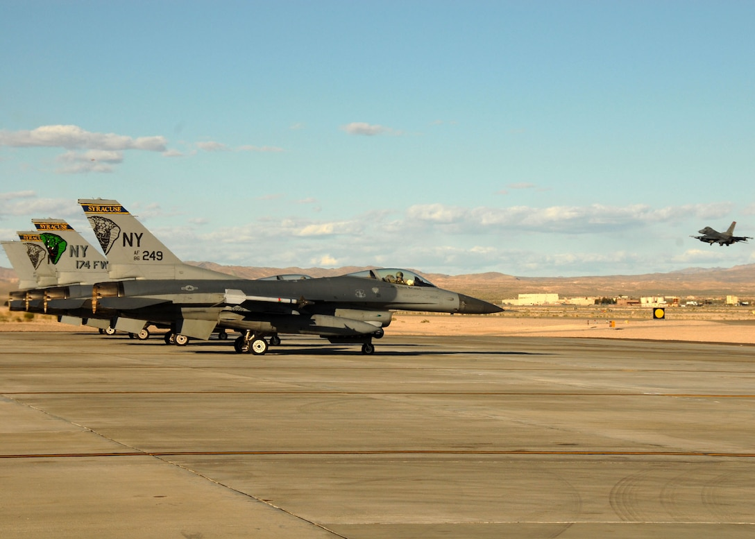 US Air Force F-16's wait their turn on the runway at Nellis AFB, NV.  The fighter jets are part of the 174th Fighter Wing out of Syracuse NY.  The unit is on its last scheduled deployment as an F-16 Wing. (US Air Force photo by SSgt Ricky Best/RELEASED)