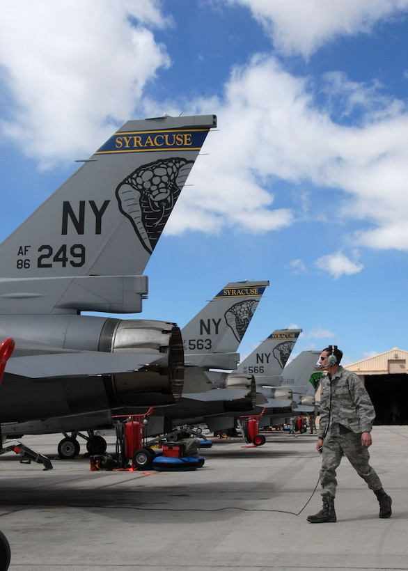 US Air Force  Staff Sgt. Jacob Wolfe performs a tail check on an NY F-16 at Nellis AFB, NV.  Staff Sgt. Wolfe is a member of the 174th Fighter Wing Syracuse, NY which is on their last deployment with the F-16s. (US Air Force photo by SSgt Ricky Best/RELEASED)