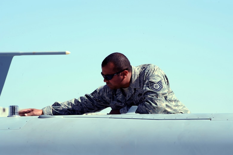 Tech. Sgt. Ismael Lopez inspects an MQ-9 Reaper for cracks and other damage March 13 at Kandahar Air Base, Afghanistan.  Sergeant Lopez is a quality assurance technician with the 62nd Expeditionary Reconnaissance Squadron. (U.S. Air Force photo/Staff Sgt. James L. Harper Jr.)