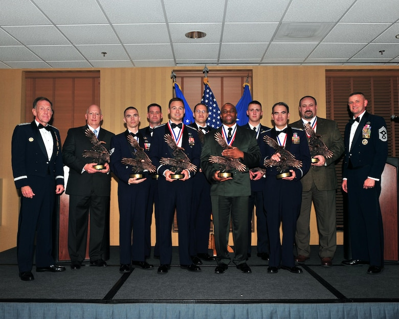 DAVIS-MONTHAN AFB, Ariz. -- Winners of the 2009 Twelfth Air Force (Air Forces Southern) Outstanding Performer of the Year awards are recognized during a ceremony here March 11, 2009.  The awards ceremony coincides with the annual Total Force Conference, a time for commanders and command chiefs from across the NAF to discuss a range of issues affecting the command. (U.S. Air Force photo by Senior Airman Noah R. Johnson)