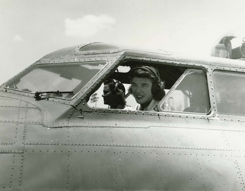 Dawn Seymour looks out the cockpit window of a B-17 Bomber during a World War II training mission. Mrs. Seymour was one of five 2009 inductees into the Women In Aviation History, Internationational Pioneer Hall of Fame. She was one of 13 women qualified to fly the giant bombers during the war. Two officers representing the 931st Air Refueling Group, Maj. Leah Schmidt and Capt. Gia Witmer, witnessed the hall of fame induction ceremony at a Women in Aviation Conference in Atlanta, Ga. (Courtesy photo)