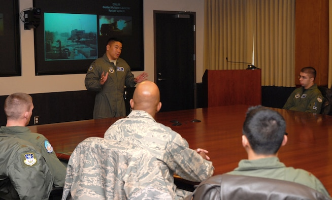 SCHRIEVER AIR FORCE BASE, Colo. - Col. Cary Chun, 50th Space Wing commander, speaks to visiting company grade officers from F.E. Warren AFB and Malmstrom AFB March 24. After a mission briefing, the CGOs visted the 2nd and 3rd Space Operations Squadrons, 22nd SOPS, the Geodesic Phased Array Antenna and 4th SOPS mobile operations. (U.S. Air Force photo/Staff Sgt. Stacy Foster)