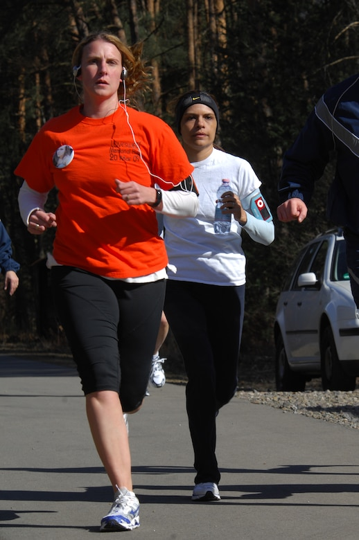Staff Sgt. Amy Mackey, NCOIC of Communication and Information Systems for the Air Force Element Personnel Exchange Program (left), charges forward during the 5K LOVESWEET memorial run, March 18, 2009, Ramstein Air Base, Germany. The run was in honor of Tech. Sgt. Jessica Sweet, 435th Communication Squadron supply troop, who lost a hard fought battle to Acute Myelogeneous Leukemia Feb. 12 (U.S. Air Force photo by Airman 1st Class Kenny Holston)