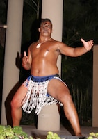 A member of the Hale Koa Hotel luau cast performs as a New Zealand native warrior. The luau features dances and traditions from Samoa, Hawaii, New Zealand and Tahiti.