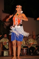 A performer at the Hale Koa Hotel luaua performs a traditional dance from New Zealand.
