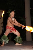 An award-winning keiki fire dancer awes the crowd with his daring moves during the Hale Koa Hotel's luau.