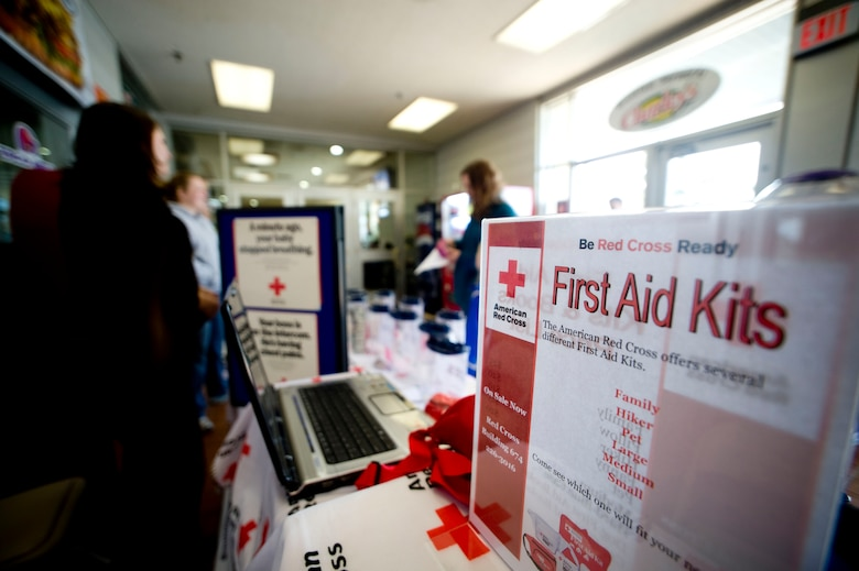 MISAWA AIR BASE, Japan -- American Red Cross pamphlets, information and first aid kits line the Misawa ARC booth at the Base Exchange March 20, 2009. Not limited to human welfare, the booth even contained first aid kits designed for pets. (U.S. Air Force photo by Staff Sgt. Samuel Morse)