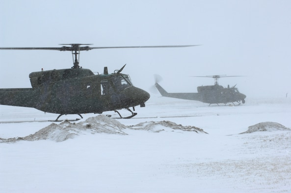 A pair of UH-1N Huey helicopters take off for Bismarck, N.D., March 25 from Minot Air Force Base, N.D., to assist in flood relief efforts.  Eight crewmembers and the two helicopters from the 54th Helicopter Squadron deployed to aid the relief efforts. (U.S. Air Force photo/Senior Airman Joe Rivera)