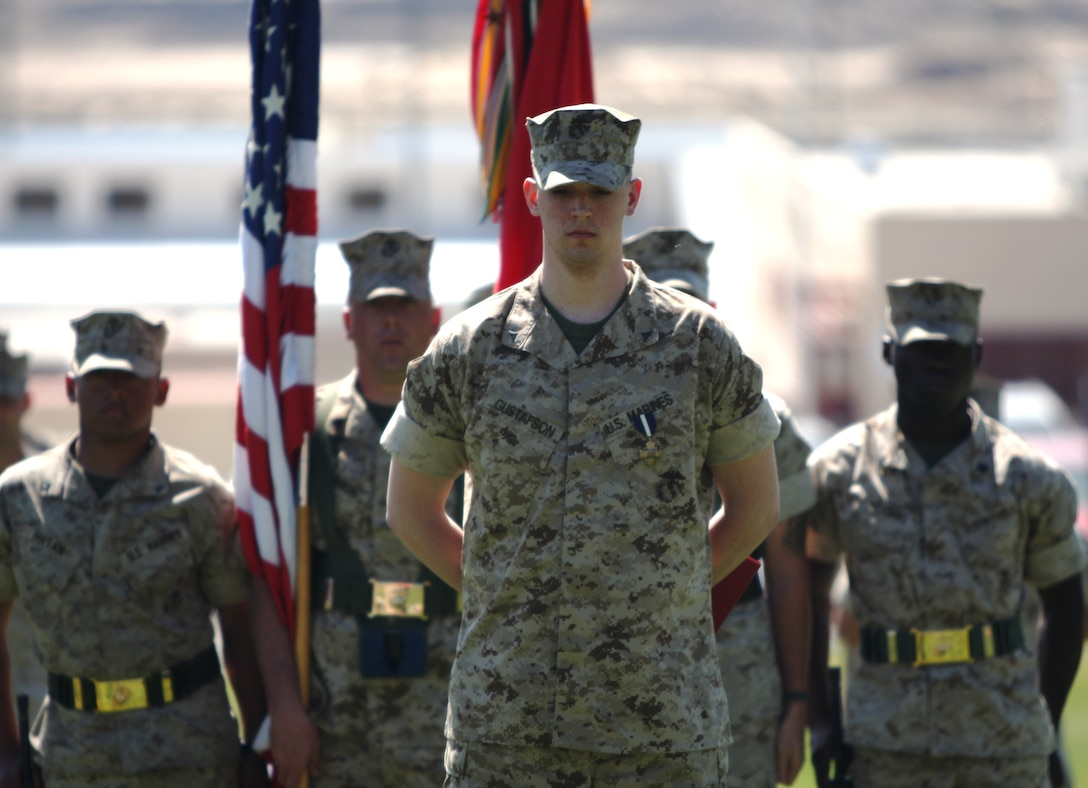 Lance Cpl. Brady Gustafson, a machine gunner with Golf Company, 2nd Battalion, 7th Marine Regiment, stands in from of the battalion at perfect parade rest, despite the amputation of his right leg below the knee. Gustafson received the Navy Cross and a meritorious promotion to corporal during a ceremony March 27 at Lance Cpl. Torrey Grey Field.