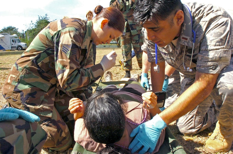 Senior Airman Kara Nicholas and 2nd Lt. Tomas Chavez check the vital signs of an incoming patient during Exercise Vigilant Guard March 25 in Camp Santiago, Puerto Rico. Airman Nicholas is a medic, and Lieutenant Chavez is a flight surgeon candidate. Both are from the 161st Air Refueling Wing from the Arizona National Guard. (U.S. Army photo/Staff Sgt. S. Patrick McCollum)