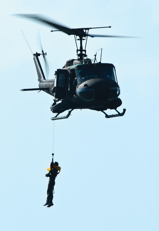 A member of the 201 AS is hoisted into a D.C. Army National Guard 